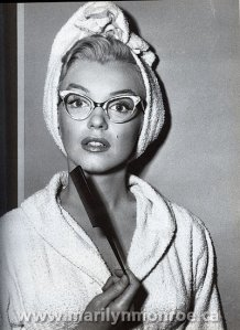 "Marilyn Monroe looking super smart in ""How to Marry a Millionaire."""