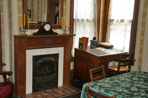 Thurber Family Dining Room with haunted clock on mantel.